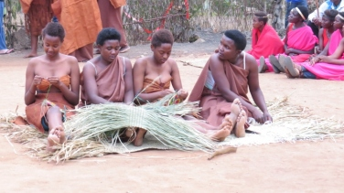 Rwandese maidens waiting to receive king Red Rocks community centre, Rwand